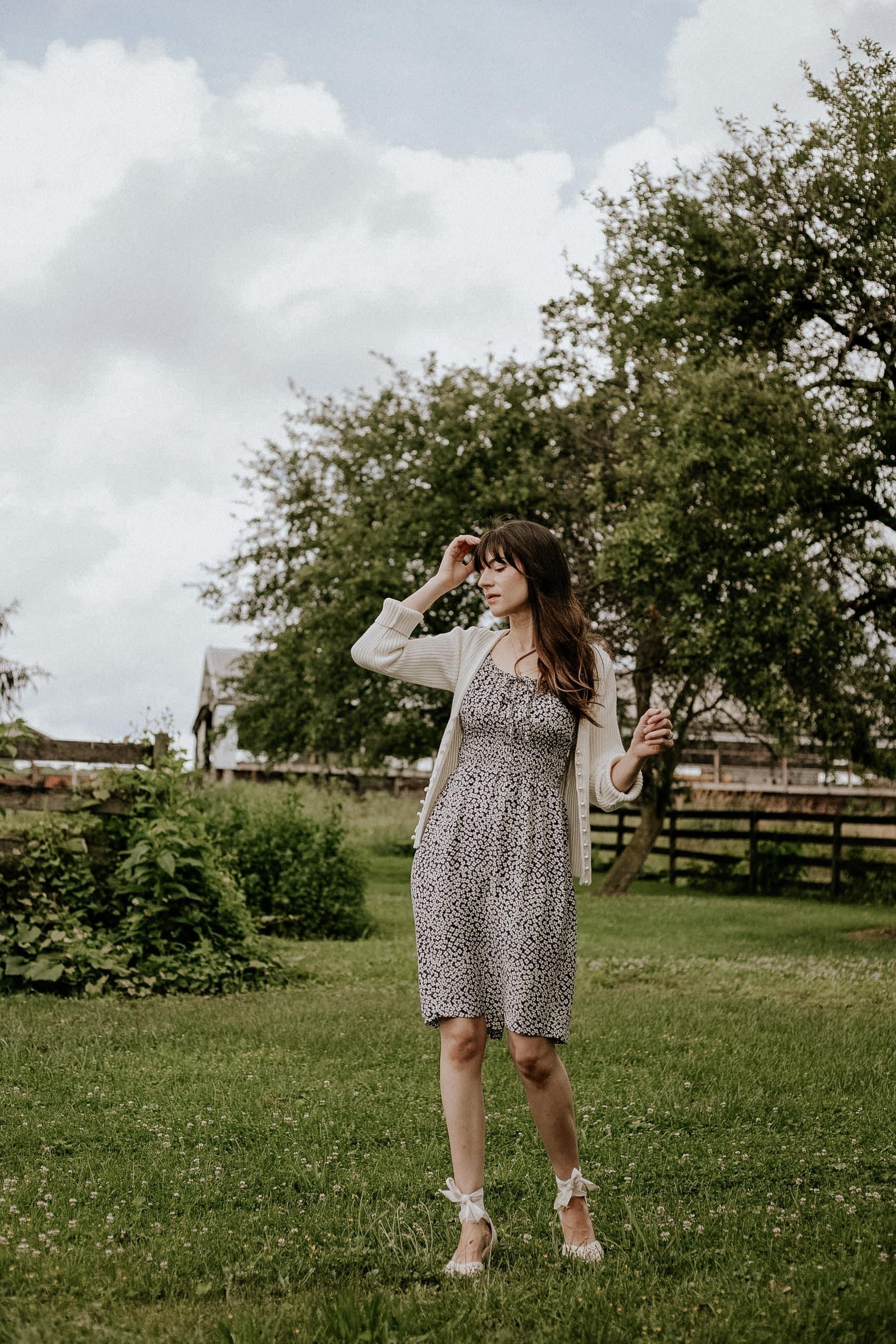 Woman in farm field wearing Rouje Dress, Musier Cardigan, Sezane Espadrilles