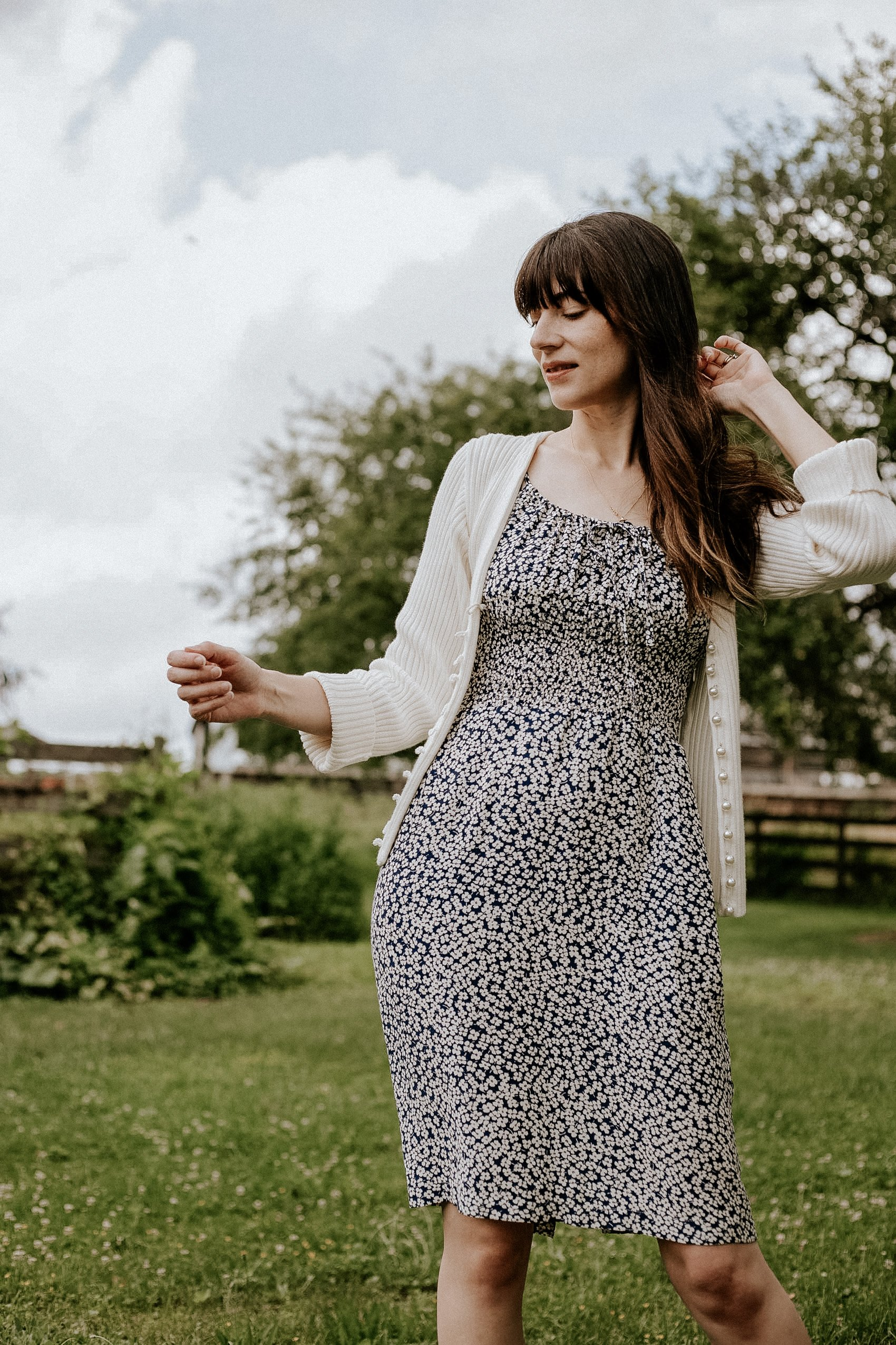Rouje Cassandre Dress Review on woman standing in field with cardigan