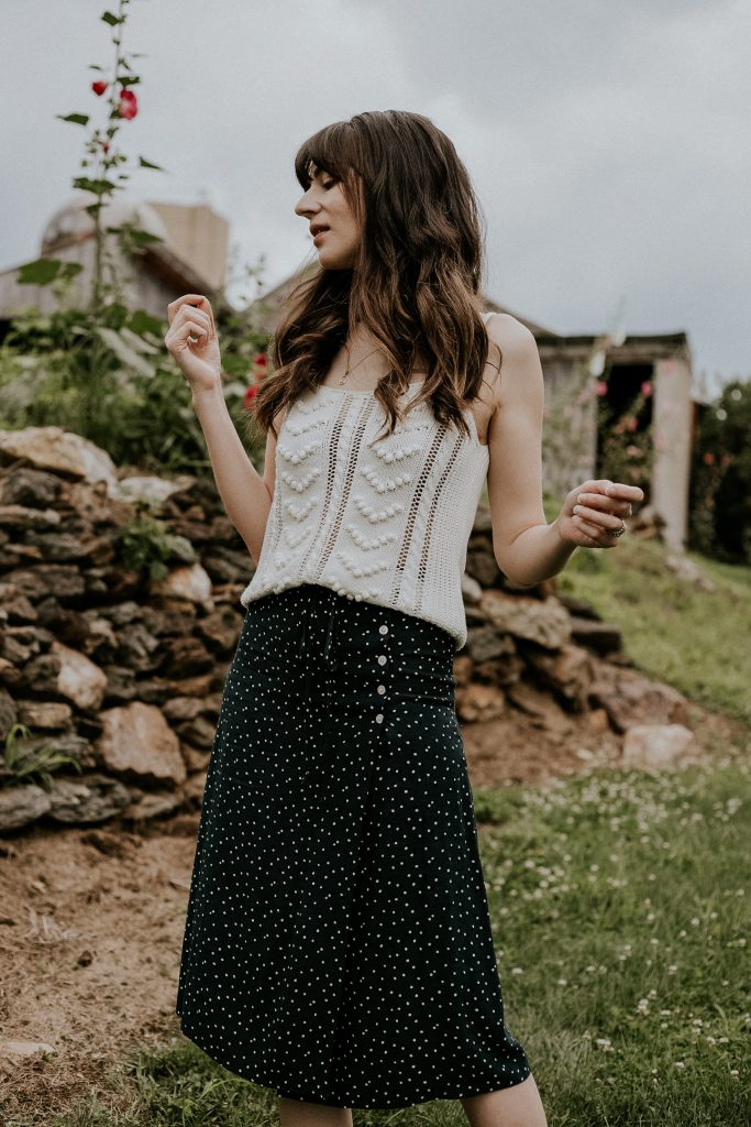 Sezane Georgie Tank with polka dot wrap skirt from Rouje Paris on woman standing on the grass