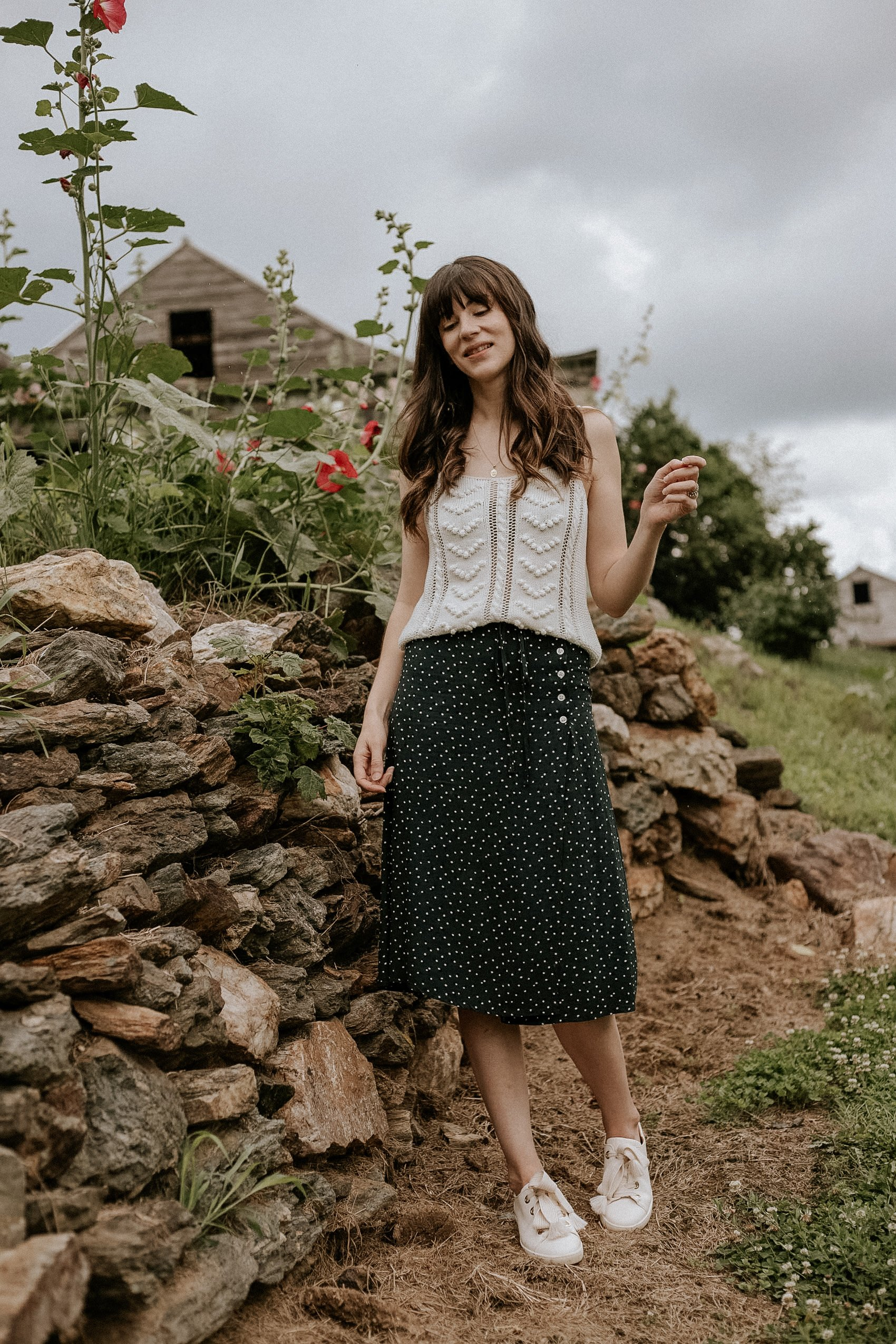 """""""Dressed up"""" casual summer outfit ft. french fashion brands Rouje and Sezane on woman standing next to a stone wall"""