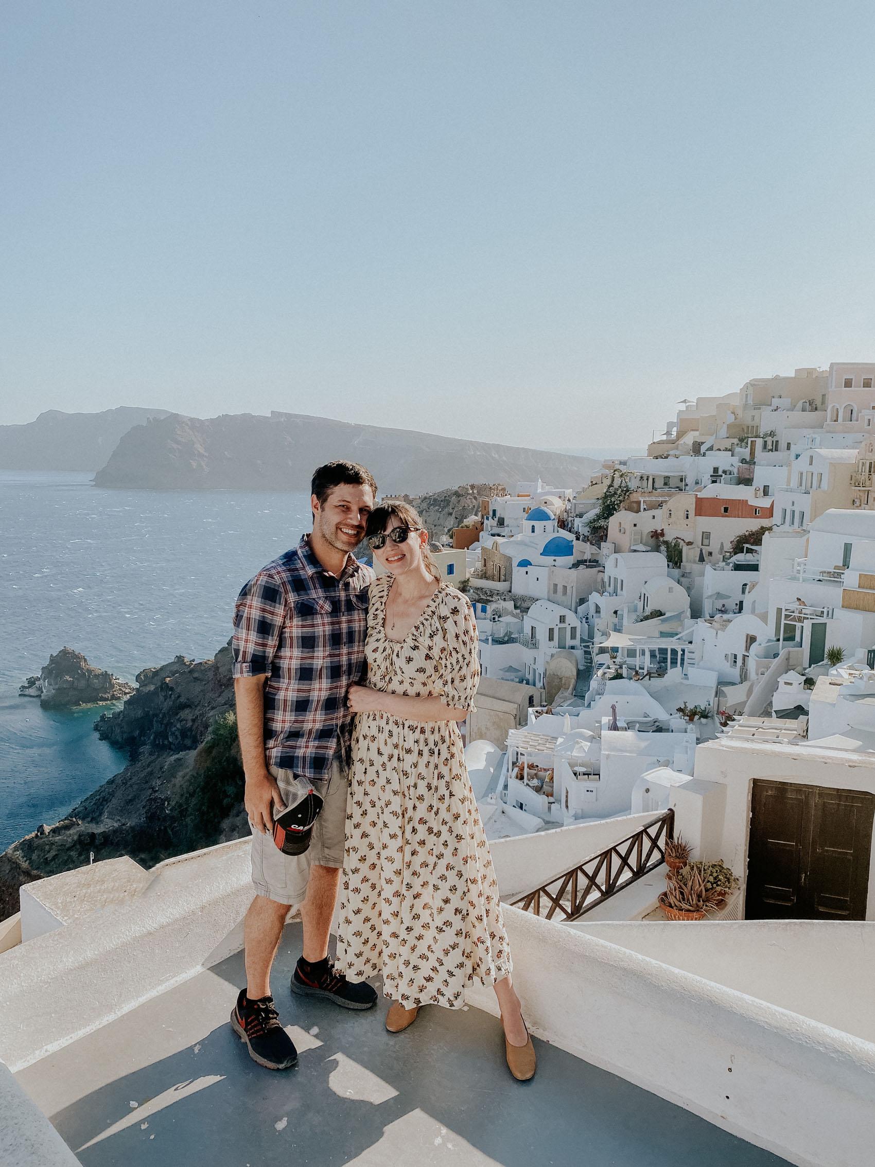 Santorini Travel Guide: A couple at photo spot in Oia Santorini