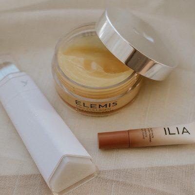 Dermstore Products flat lay: Dermaflash Dermapore, Elemis Cleansing Balm, ILIA color haze