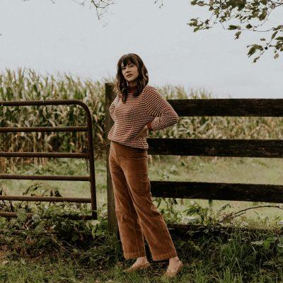 Amour Vert Sweater, Everlane Corduroy Wide Leg Pants on woman on farm