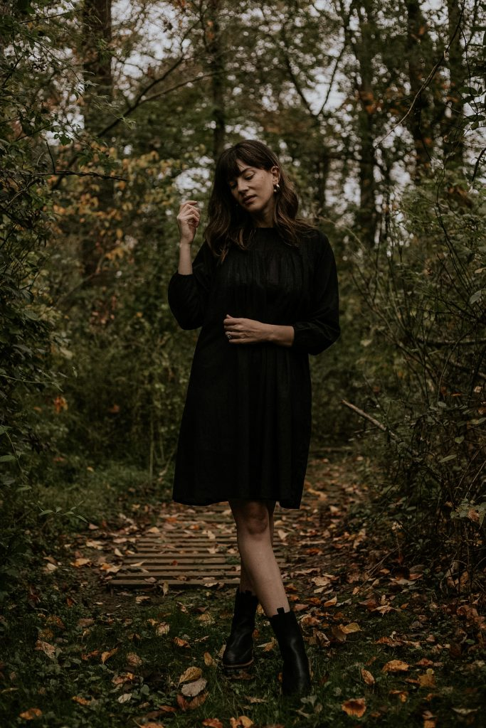 Laude the Label Juliette Dress with Freda Salvador Boots on woman in the woods